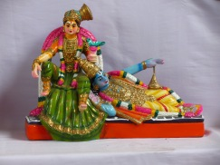 Lord_Krishna_with_his_head_on_the_lap_of_the_Alvar_saint,_Andal